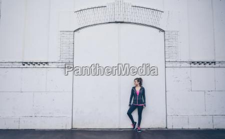 woman wearing sports wear standing in