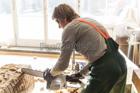 wood carver in workshopworking on wood