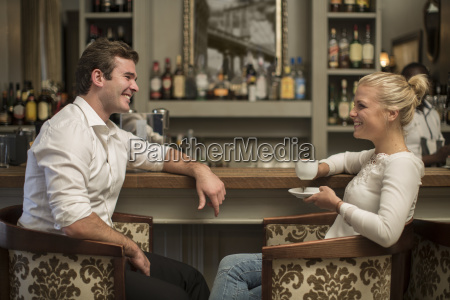 young man and woman socializing in