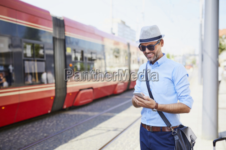 traveler in the city using cell