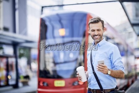 businessman using phone after getting off