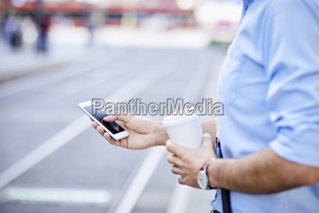 close up of businessman using phone