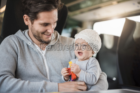 happy father with baby girl traveling