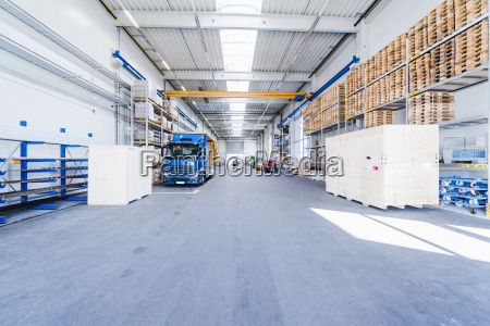 factory hall with truck and pallets