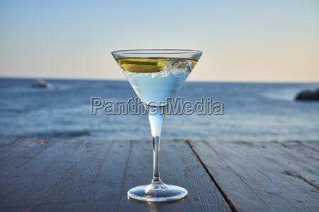 glass of ice cooled martini with