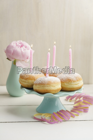 birthday candles on bismarck doughnuts