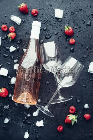 bottle of rose wine two empty