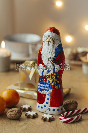 chocolate santa with presents fruits and