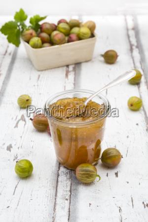 jar of gooseberry jam and gooseberries