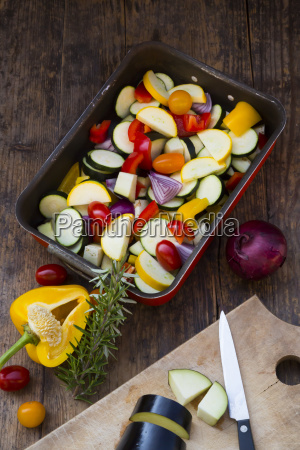 raw mediterranean oven vegetables on roasting