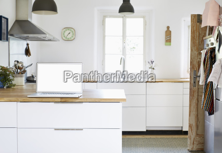 laptop standing on worktop in a