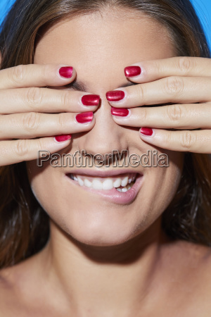 beautiful young woman with red fingernails