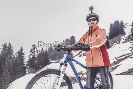 austria damuels woman with mountain bike