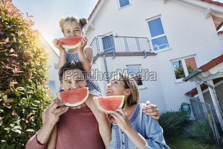 portrait of happy family with slices