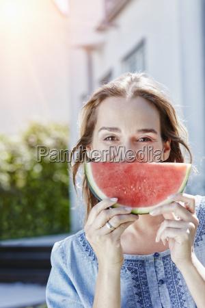 portrait of happy woman with slice