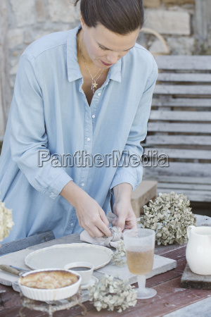 italy woman laying breakfast table on