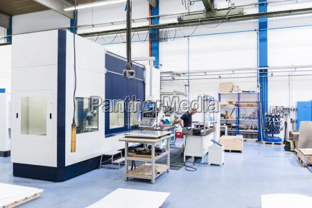 man working in factory shop floor