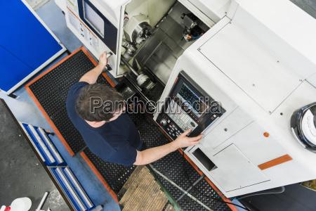 top view of man operating machine