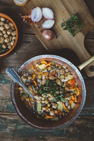 mediterranean soup in copper pot bowl