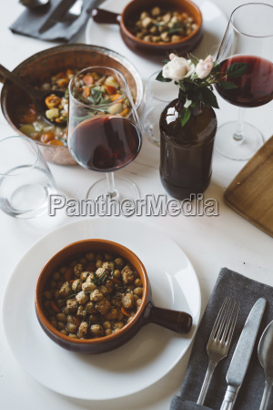 laid table with mediterranean soup and