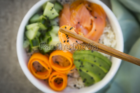 sushi bowl with salmon cucumber avocado