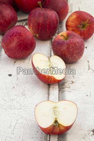 red apples on wood halved