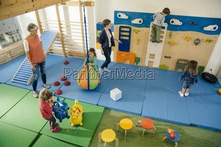 pre school teachers and children in