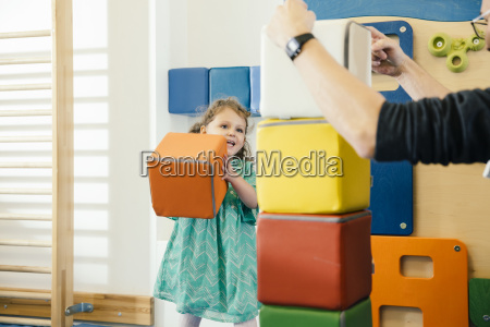 happy little girl lifting up a