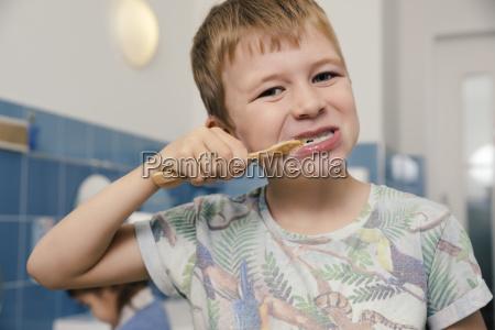 portrait of boy brushing his teeth