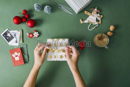 womans hands packing christmas gift