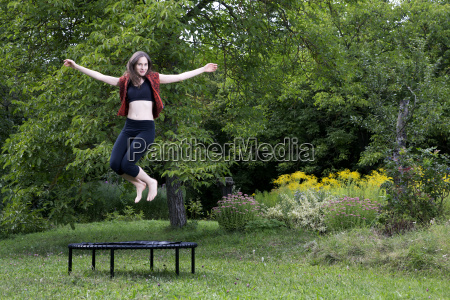 woman jumping on trampoline in the