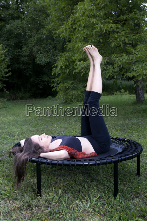 woman lying on trampoline in the