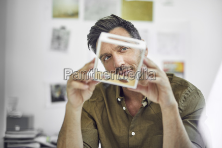 portrait of man checking component in