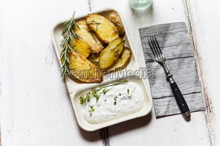 bowl of potato wedges with rosemary
