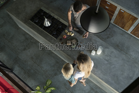 family preparing healthy breakfast in comfortable