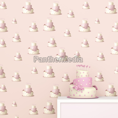 pink and white birthday cake in