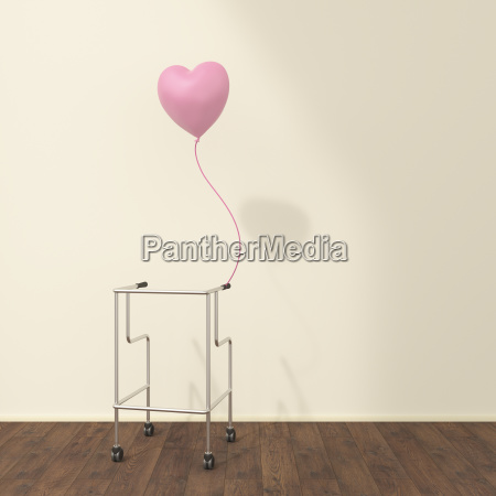 wheeled walker and pink balloon in