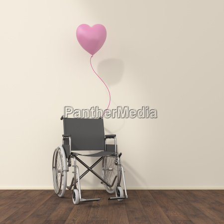 wheelchair and pink balloon in a