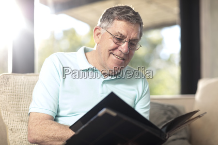 smiling senior man sitting on couch