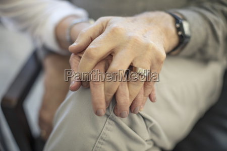 close up of senior couple holding