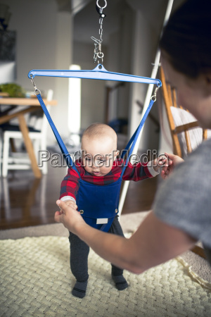mother with baby in baby walker