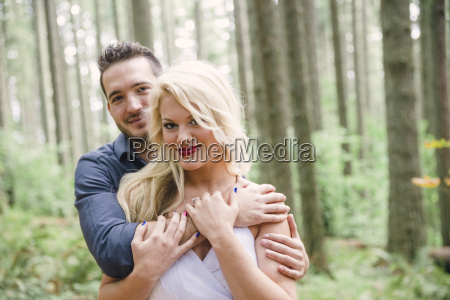 portrait of young couple hugging and