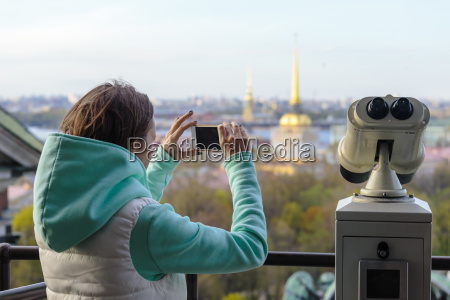 young woman with phone at observation