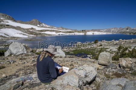 man watercolor painting at muriel lake