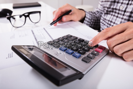 businessman's, hands, calculating, invoice - 23578500