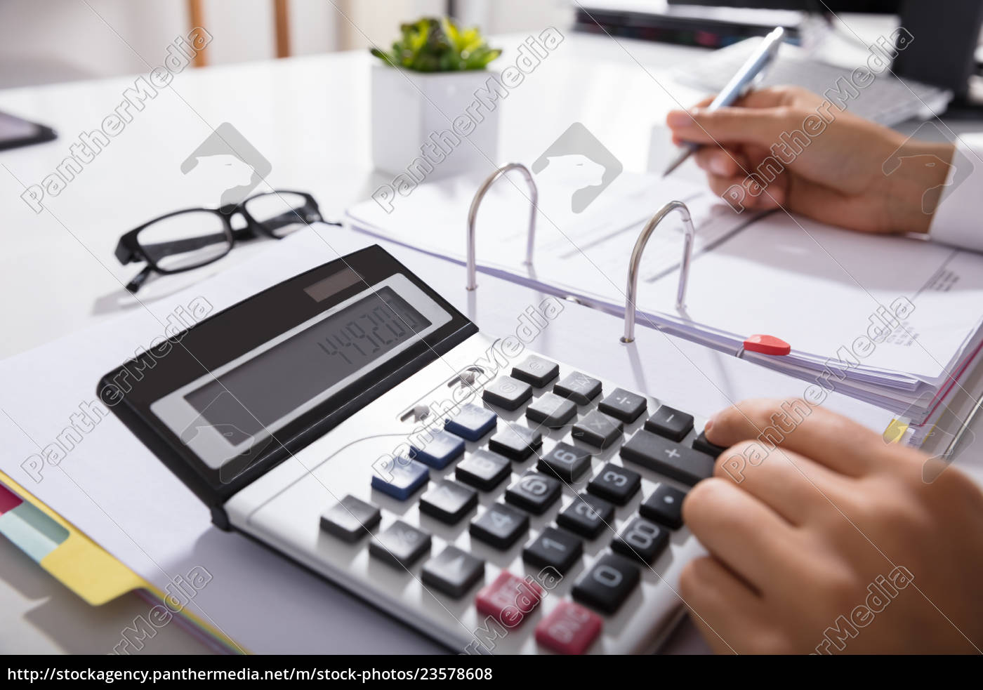 businessperson, calculating, bills, in, office - 23578608