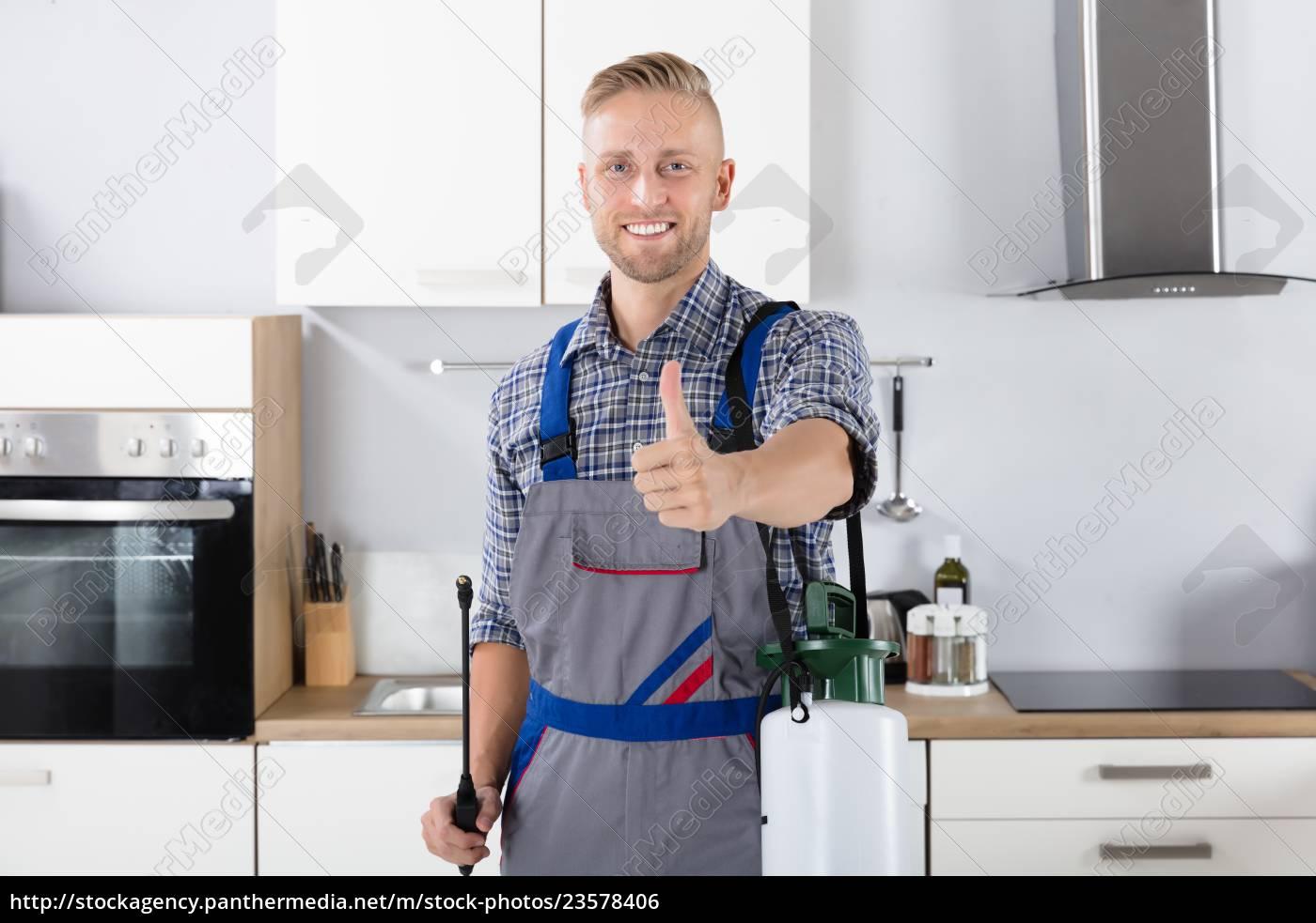 confident, pest, control, worker, with, pesticide - 23578406