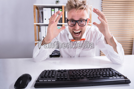 keyboard, in, front, of, pointing, businessman - 23578564
