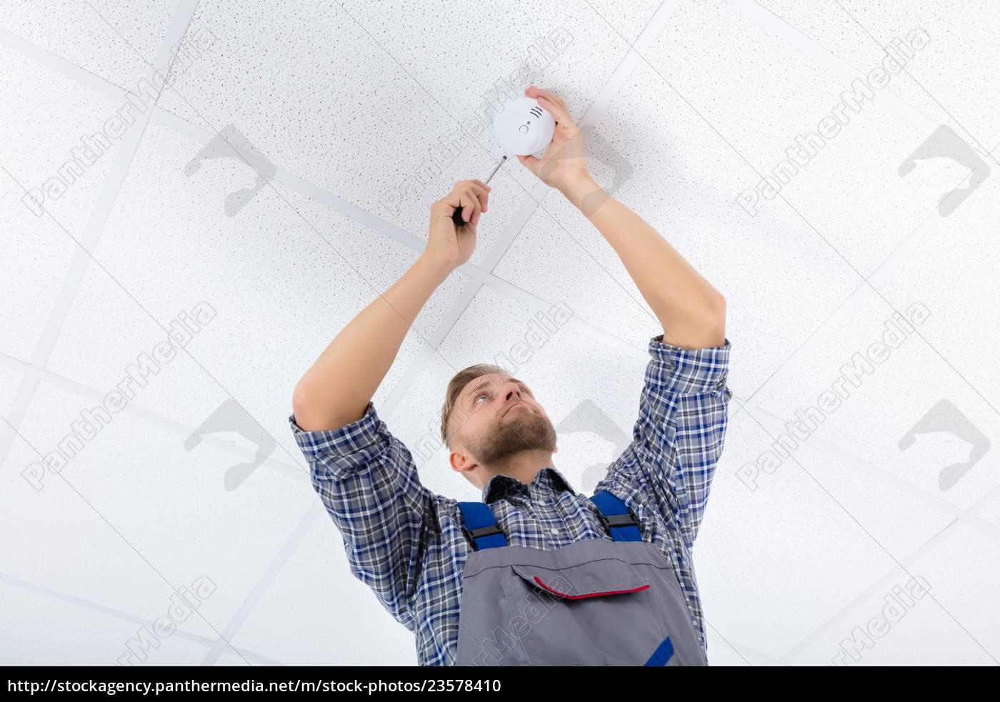 male, electrician, fixing, smoke, detector - 23578410