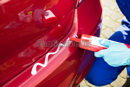 person's, hand, wearing, gloves, applying, cleaner - 23578462